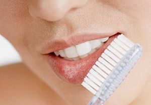 Rubbing-lips-lightly-with-a-dry-toothbrush